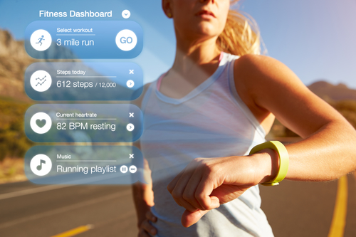 Exercising Woman Checking Notifications On Health Tracker